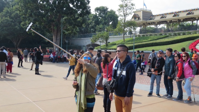Selfies at the Disney entrance.   How many adults do you see?  Now how many children can you find?  Exactly.